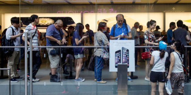 People queue inside an Apple store to buy the new iPhone 6 and 6 Plus in Hong Kong October 9, 2014. The...