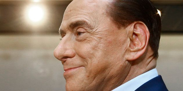 Former Italian Prime Minister Silvio Berlusconi arrives ahead of a memorial ceremony in honour of late...
