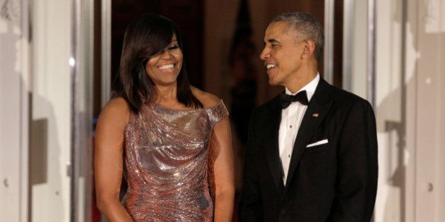 U.S. President Barack Obama and U.S. first lady Michelle Obama speak before the arrival of Italian Prime...