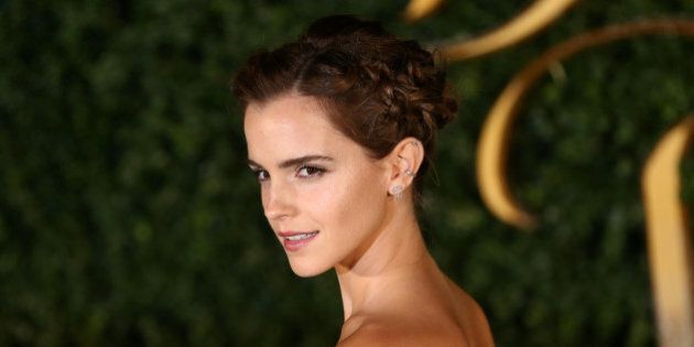 Actor Emma Watson poses for photographers at a media event for the film Beauty and the Beast in London,...