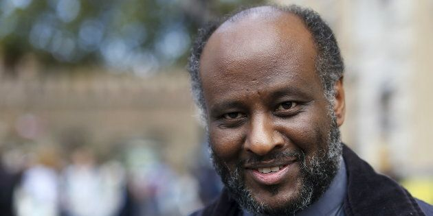 Eritrean priest Mussie Zerai smiles during an interview in front of Saint Peter's Square at the Vatican...