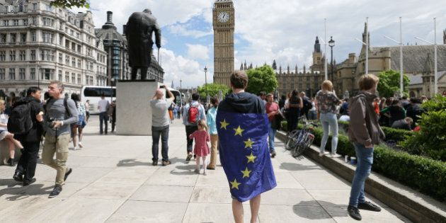 A demonstrator wrapped in the EU flag takes part in a protest opposing Britain's exit from the European...