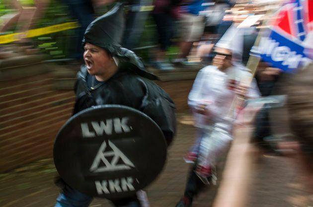 Members of the Ku Klux Klan arrive for a rally, calling for the protection of Southern Confederate monuments,...