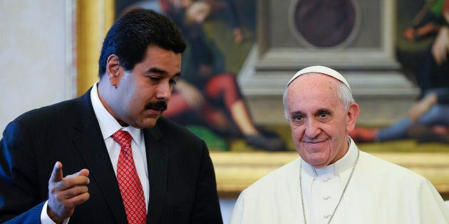 Pope Francis poses with Venezuela's President Nicolas Maduro during a meeting at the Vatican June 17,...