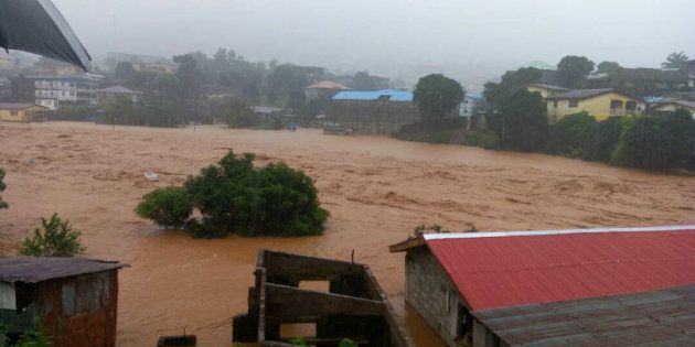 In this image made available by Society 4 Climate Change Communication, Sierra Leone, mud and water flow...