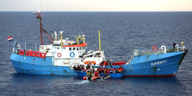 Migrants on a wooden boat are rescued by German NGO Jugend Rettet
