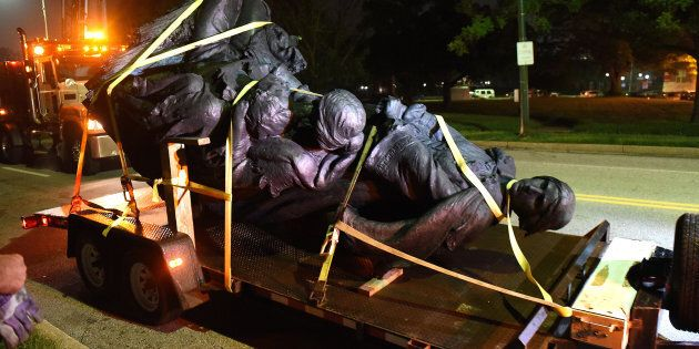 A monument dedicated to the Confederate Women of Maryland lies on a flatbed trailer near the intersection...