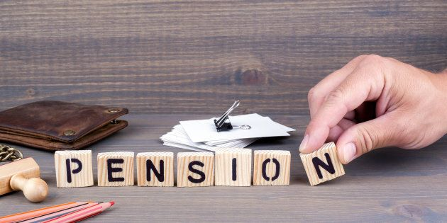 pension concept.Wooden letters on dark background. Office