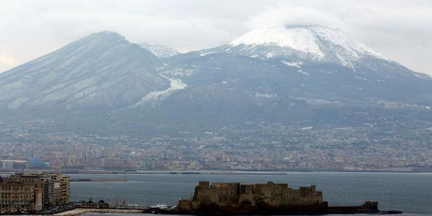 A view of the Vesuvio volcano covered by snow is seen in Naples, February 6, 2012. Bitterly cold weather...