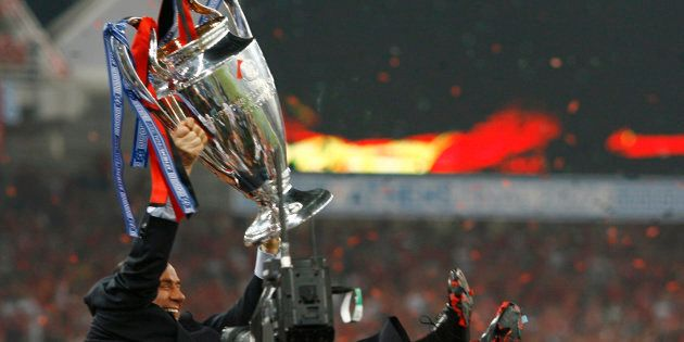 Former Italian Prime Minister Silvio Berlusconi lifts the trophy after AC Milan defeated Liverpool in...