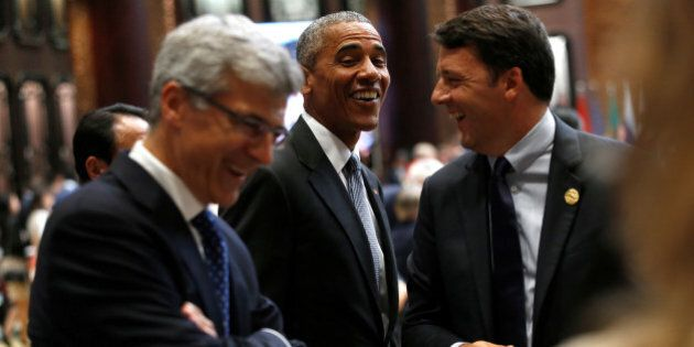 U.S. President Barack Obama (C) talks to Italian Prime Minister Matteo Renzi (R) during the opening of...