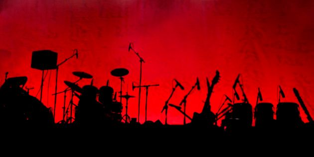 A stage in silhouette before a