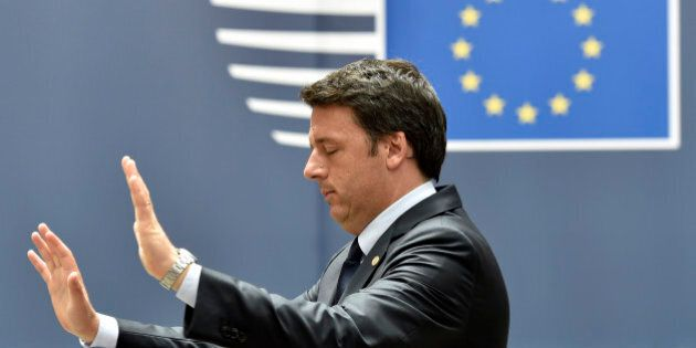 Italian Prime Minister Matteo Renzi gestures as he leaves the EU Summit in Brussels, Belgium, June 28,...
