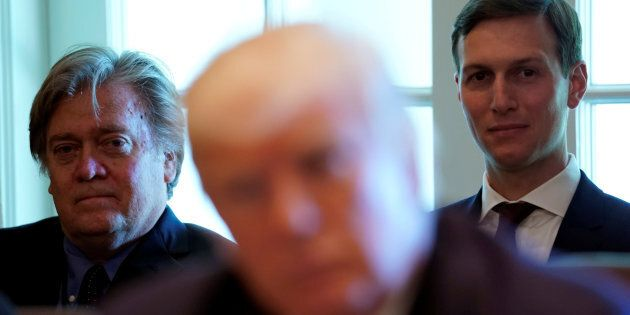 Trump advisers Steve Bannon (L) and Jared Kushner (R) listen as U.S. President Donald Trump meets with...