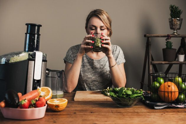 Woman juicing with fresh fruit and