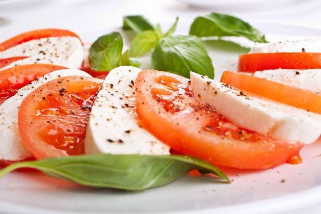 classic caprese salad - tomatoes, mozzarells and