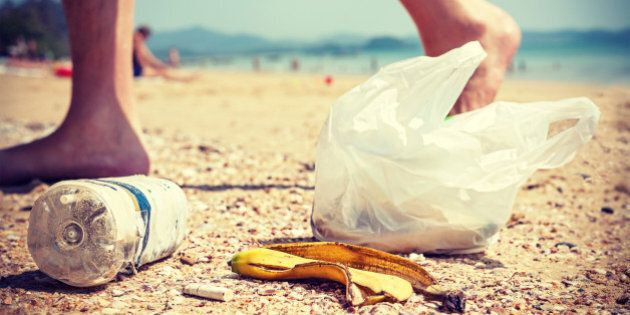 Vintage instagram style picture of garbage left by tourists on a beach, environmental pollution concept