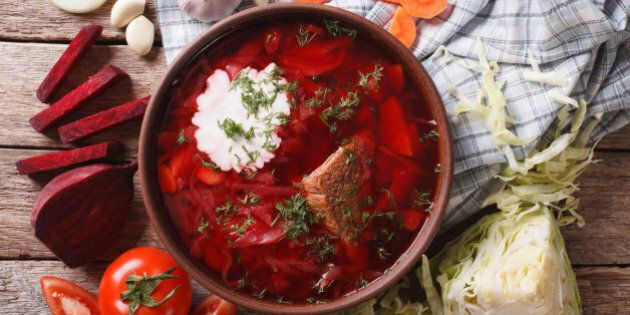 Ukrainian borsch soup and ingredients on the table close-up. Horizontal view from