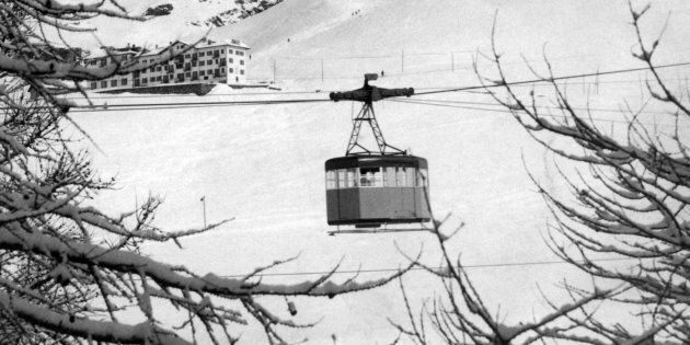 The snowy peak of Mount Cervino, in the western Alps; in the center, a cable car. Western Alps, Cervino...