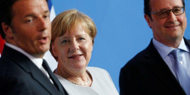 German Chancellor Angela Merkel (C), French President Francois Hollande (R) and Italian Prime Minister...