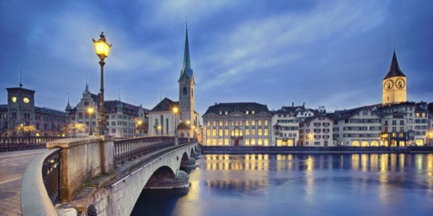 view on Fraumunster Church and Church of St. Peter at night, Zurich,