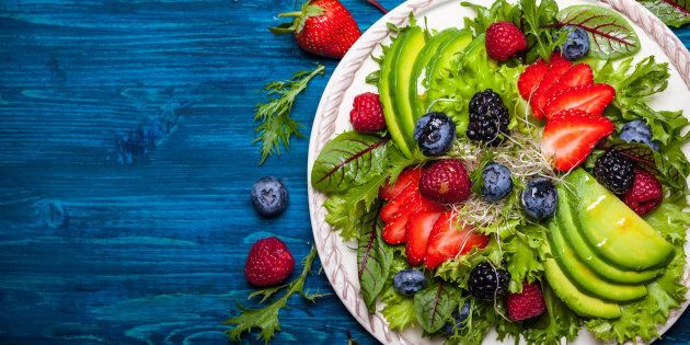 Mixed salad leaves with berries, avocado and honey-mustard