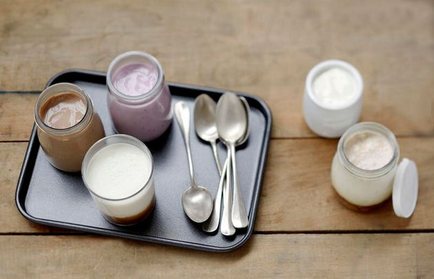 Selection of different flavored homemade yogurts and panna cotta Selection of different flavored homemade...