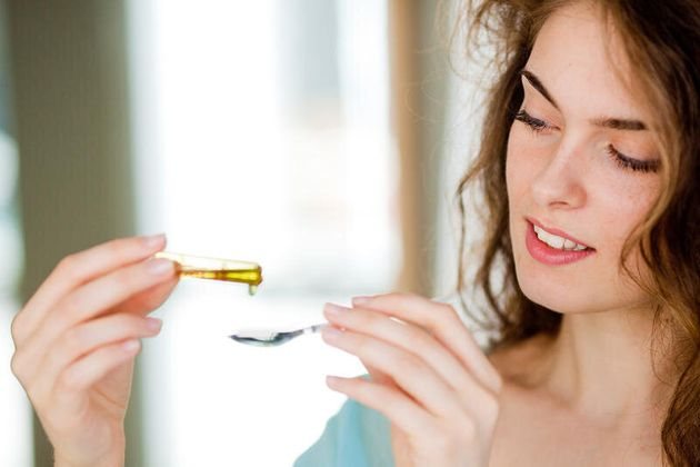 Woman holding glass ampoule of vitamin D. Woman holding glass ampoule of vitamin