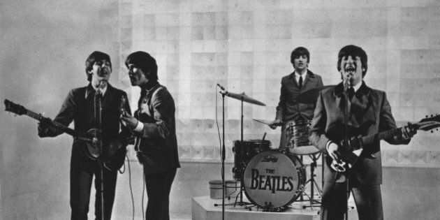 The Beatles are seen performing, date unknown. From left to right: Paul McCartney, George Harrison, Ringo...