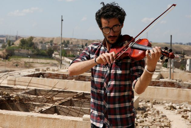 Ameen Mukdad, a violinist from Mosul who lived under ISIS's rule for two and a half years where they...