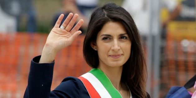 Rome's Mayor Virginia Raggi waves to reporters as she leaves the Rome's Vittoriano Unknown soldier monument,...