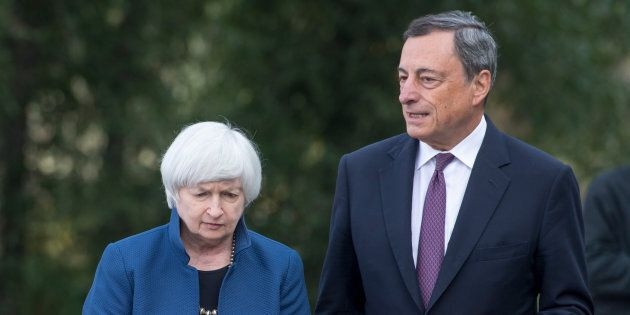 Janet Yellen, chair of Board of Governors of the Federal Reserve System, left, and Mario Draghi, president...