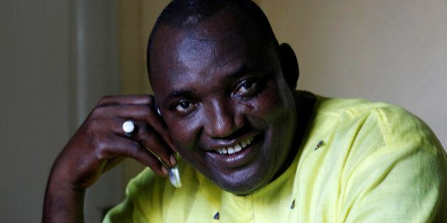 The new president of Gambia, Adama Barrow smiles as he makes a call at his home in Yarambamba, West Coast...