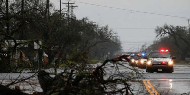 A fallen tree lies along a road as an emergency response team arrives to assess damage from Hurricane...