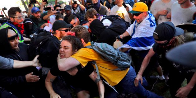 BERKELEY, CA - AUGUST 27: Fighting breaks out at Martin Luther King Park in Berkeley where counter protesters...