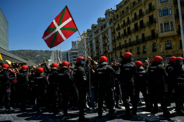 Basques pro-independence supporters hold Ikurrina (Basque flags and Catalonia independence flag known...
