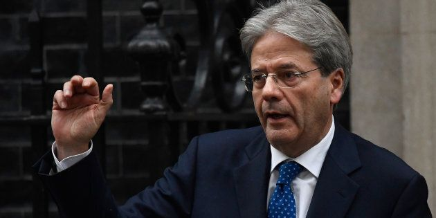Italy's Prime Minister Paolo Gentiloni waves as he leaves after meeting his counterpart from Britain...