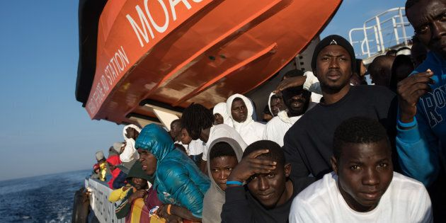 VIBO VALENTIA, ITALY - NOVEMBER 24: Refugees on the the MOAS vessel 'Topaz Responder' as it comes into...