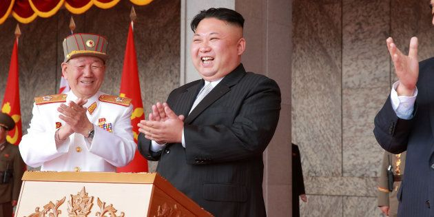 North Korean leader Kim Jong Un applauds during a military parade and a public procession of Pyongyang...