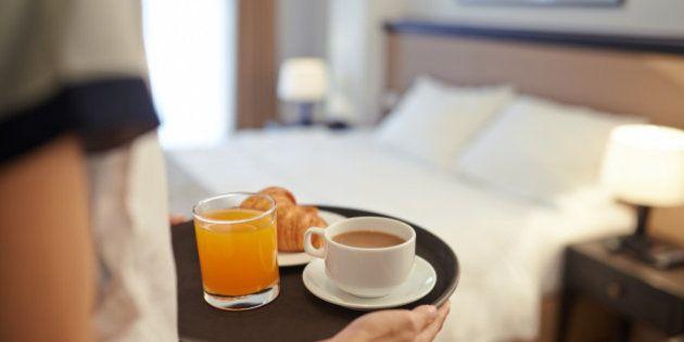 Waitress bringing breakfast to the hotel