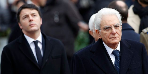Italy's newly elected president Sergio Mattarella (R) and Prime Minister Matteo Renzi pay their respects...
