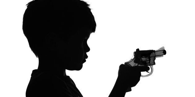 B&W Silhouette of a boy holding a toy
