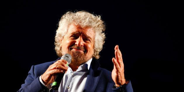 Beppe Grillo, the founder of the anti-establishment 5-Star Movement, talks during a march in support...