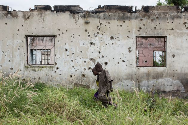 Bullet holes mark the wall of a destroyed boarding house in Banki, on September 19, 2016. Banki, formerly...