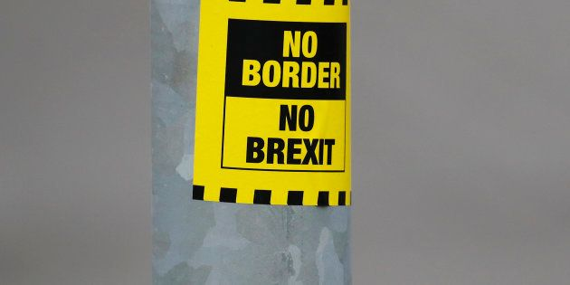 A sticker opposing Brexit is seen on a street in Londonderry, Northern Ireland, March 23, 2017. REUTERS/Phil