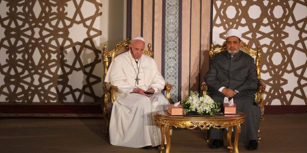 Pope Francis sits next to Ahmed al-Tayeb, Grand Imam of Egypt's al-Azhar Institution during their meeting...