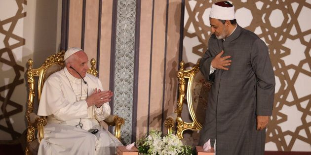 Pope Francis greets Al-Azhar's Grand Imam Ahmed al-Tayeb during a meeting at Cairo, Egypt April 28, 2017....