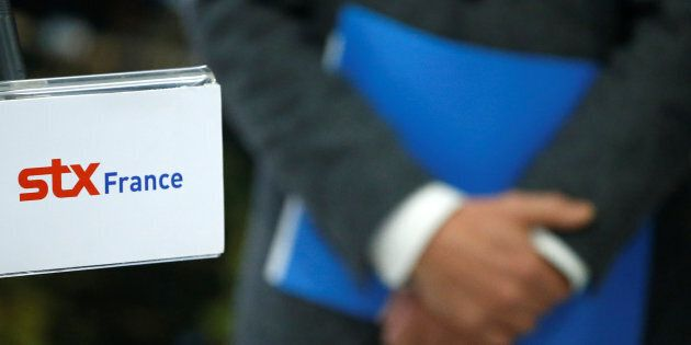The logo of STX is seen during a press conference at the STX Les Chantiers de l'Atlantique shipyard site...
