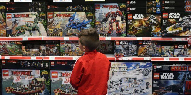 A young boy looks at Lego set for sale at the BRICKLIVE event for Lego fans at the Titanic Exhibition...