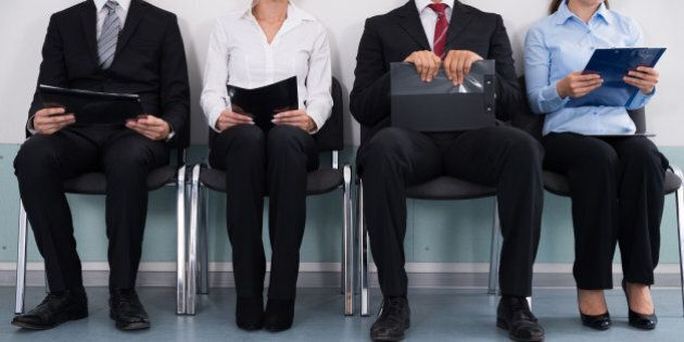 Close-up Of Businesspeople With Files Sitting On
